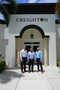 Charley Carpenter, Dan Creighton and Brent Evans stand in front of Creighton Construction & Development's Fort Myers office
