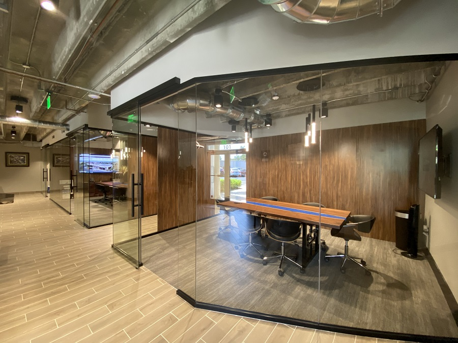 Conference rooms featuring a mid-century modern design at Creighton Construction & Development's Fort Myers office