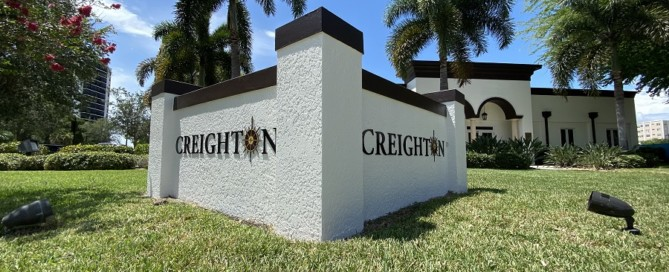 Company signage in front of Creighton Construction & Development's office in Fort Myers, Florida